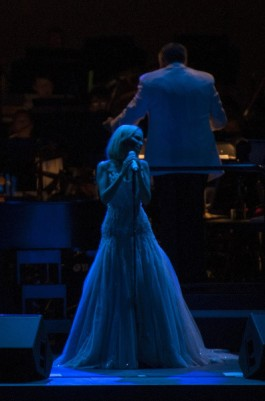 "Singer and actress Kristen Chenoweth performs ""Moon River"" Friday at the Hollywood Bowl in her headlining performance with the Los Angeles Philharmonic conducted by Kevin Stites. ///ADDITIONAL INFO: chenoweth.0824 - 8/23/13 - Photo by MIGUEL VASCONCELLOS / FOR THE ORANGE COUNTY REGISTER - Review of Tony-winning singer and actress Kristen Chenoweth in the first of two headlining appearances at the Hollywood Bowl. Please also try to get a few fan pics to mix up the slideshow. Probably a soundboard shoot, as usual.. - GENERIC CAPTION"